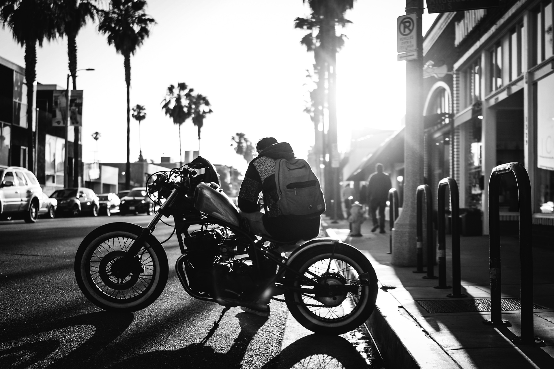 man on motorcycle black and white